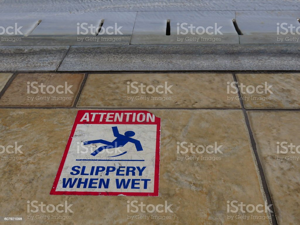 Attention, slippery floor stock photo
