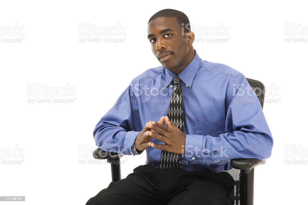 Attentive Businessman in Chair stock photo