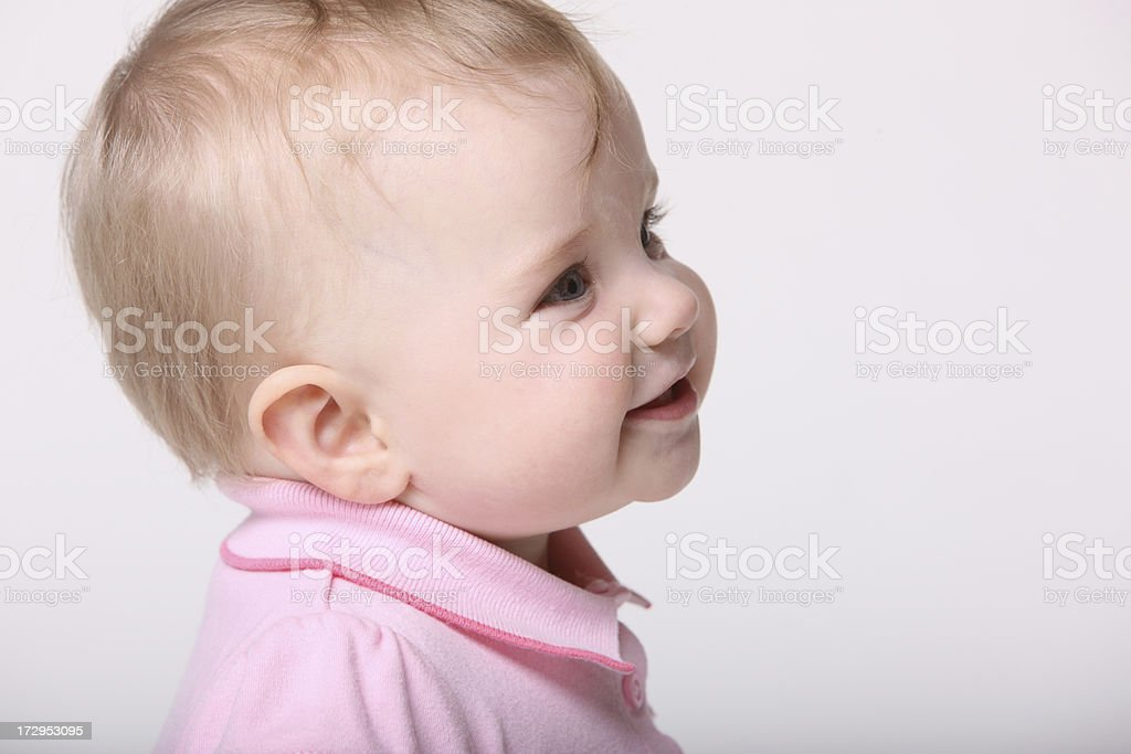 Attentive Cute Baby Girl Trying to Talk royalty-free stock photo