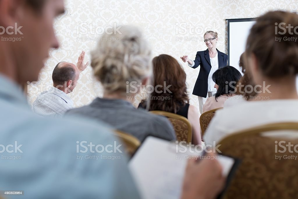 Attentive listener during scientists convention stock photo