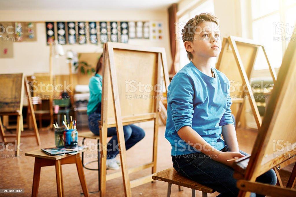 Attentive little listener stock photo