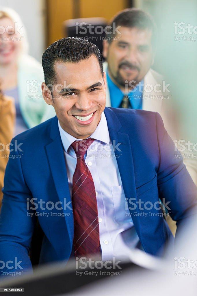 Attentive mid adult Hispanic businessman during a seminar stock photo