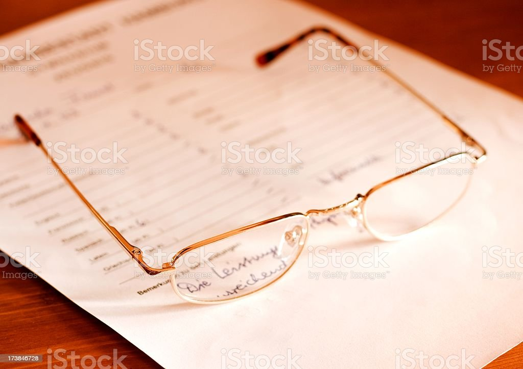 attestation- glasses on document stock photo