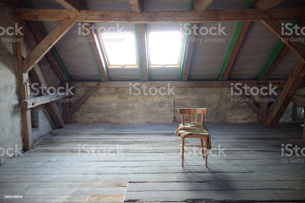 Attic with exposed beams and roof windows stock photo