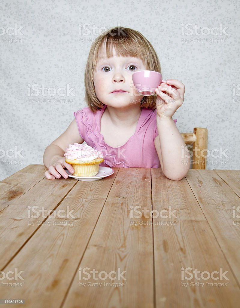 Attitude tea party - girl with pink cup and cupcake royalty-free stock photo