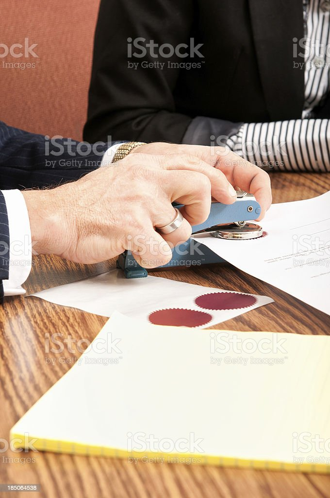 Attorney Sealing a Legal Document stock photo