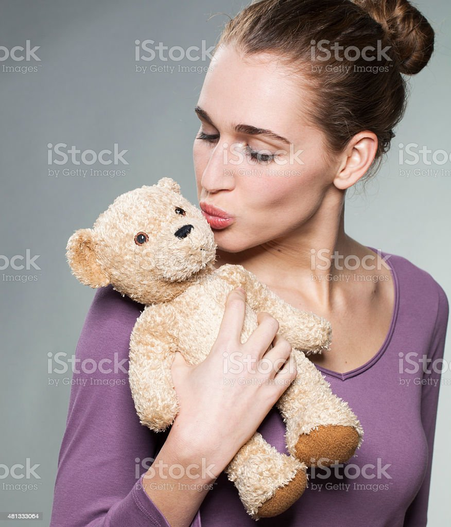attractive 20s girl hugging her favorite comforter with care stock photo