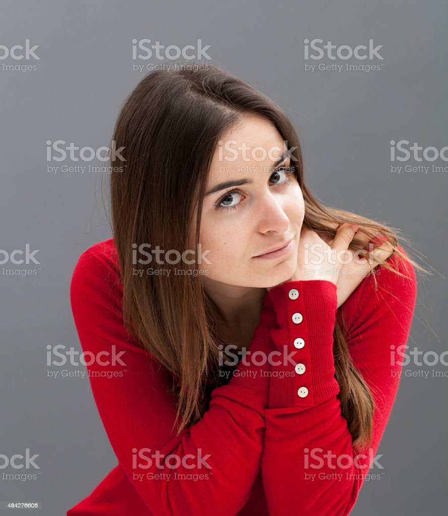 attractive 20s woman focusing on herself stock photo