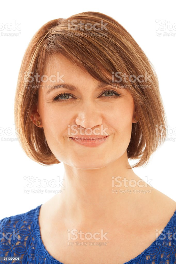Attractive adult woman looking at camera while smiling stock photo