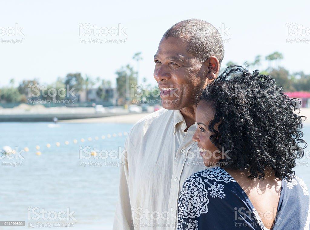 Attractive African American Couple a near marina stock photo