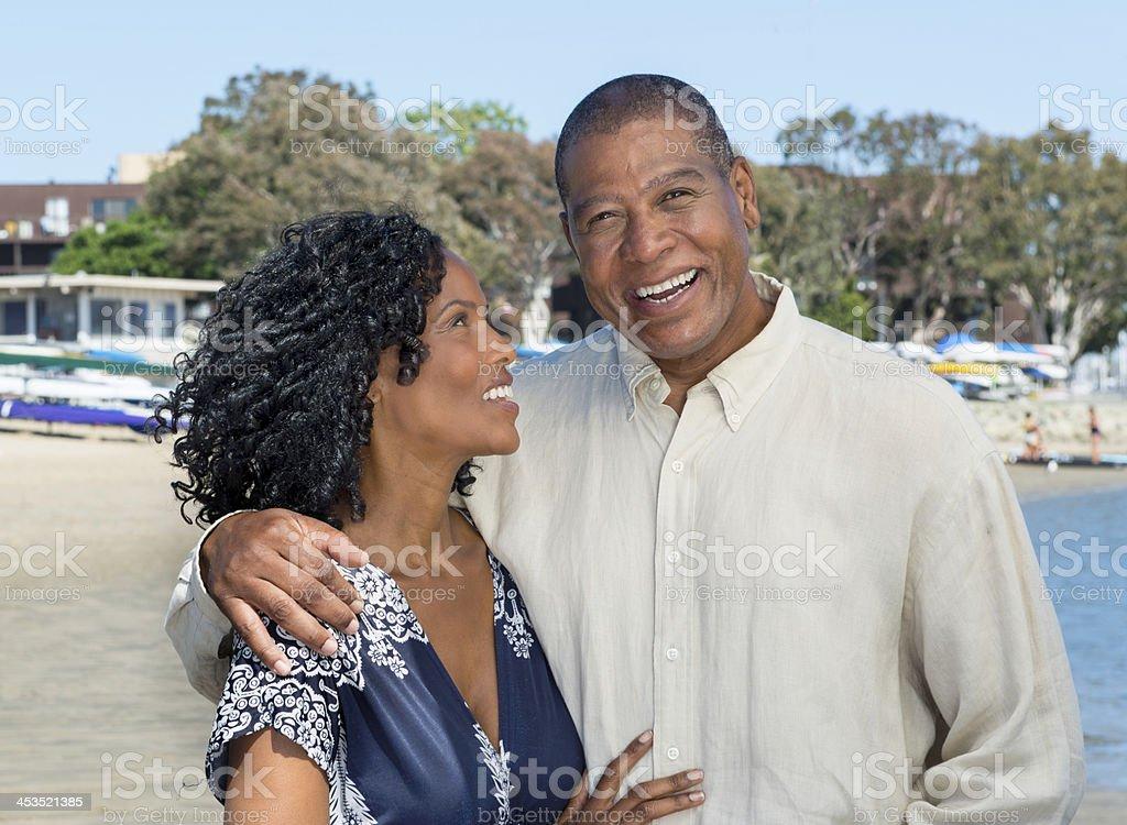 Attractive African American Couple near marina stock photo