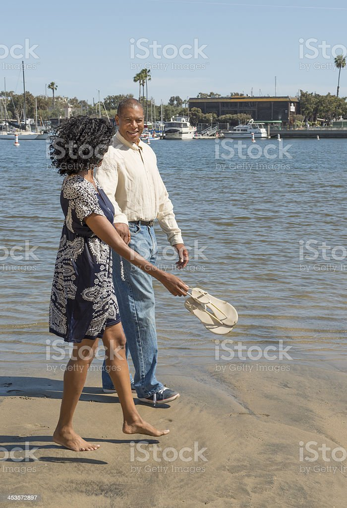 Attractive African American Couple walking on Beach stock photo