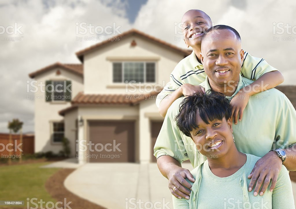 Attractive African American Family in Front of Home stock photo