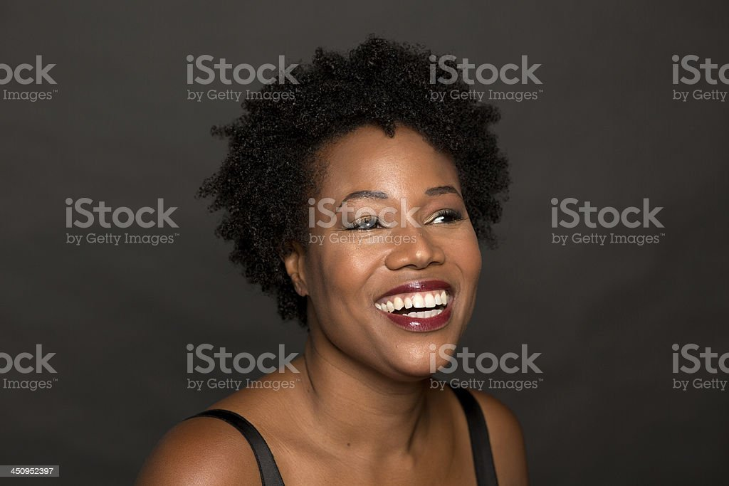 attractive african american woman smiling stock photo