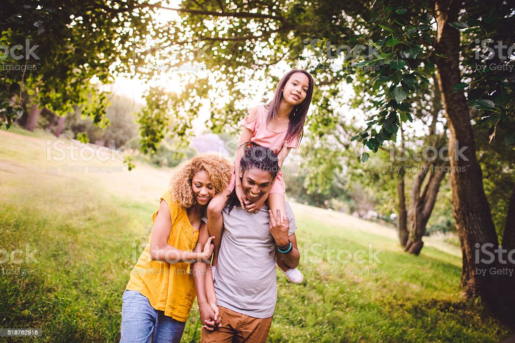 Attractive African-American family having a stroll together in b stock photo