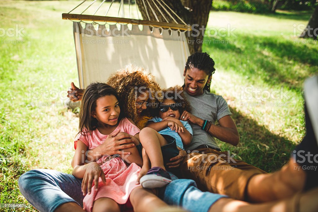 Attractive African-american family spending family time in a bea stock photo