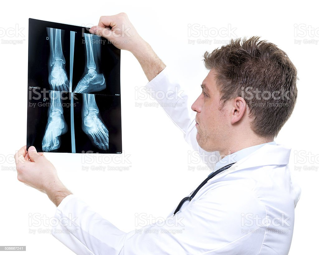 attractive and expressive doctor holding x-ray royalty-free stock photo