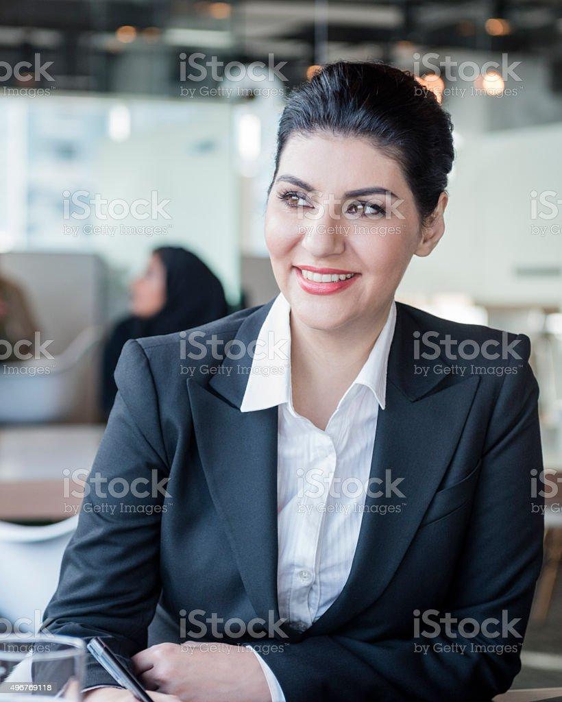 Attractive Arab businesswoman in modern office stock photo