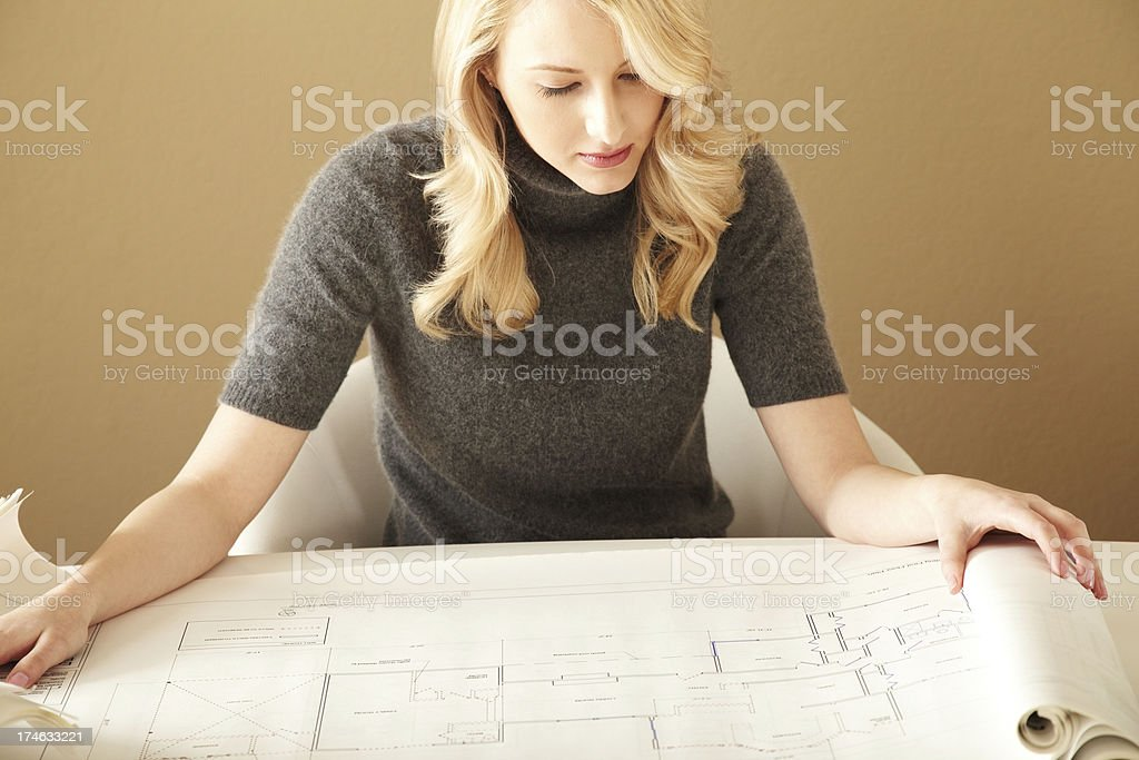 Attractive architect Looking at architectural plans royalty-free stock photo