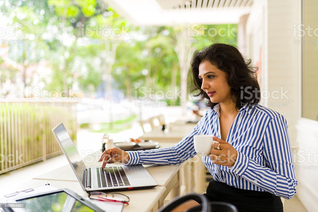 Attractive Asian Business Woman Working Away From Office stock photo