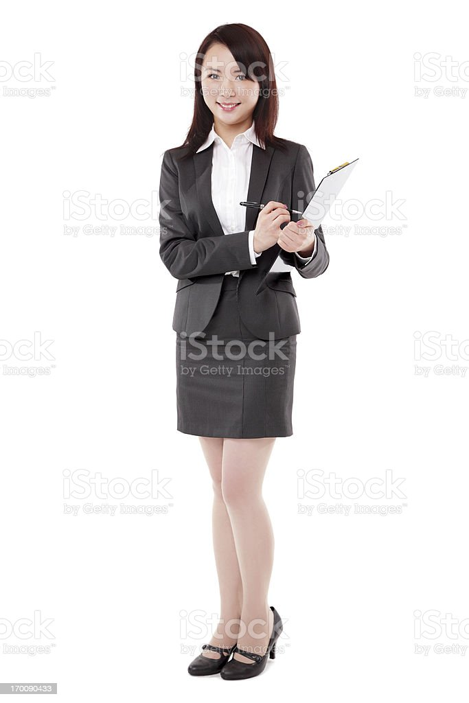 Attractive Asian Businesswoman Taking Notes Smiling on White Background stock photo