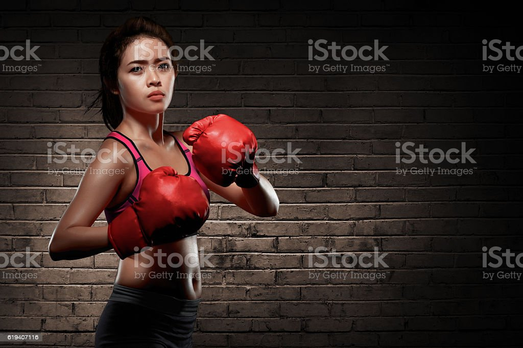 Attractive asian female boxer at training stock photo