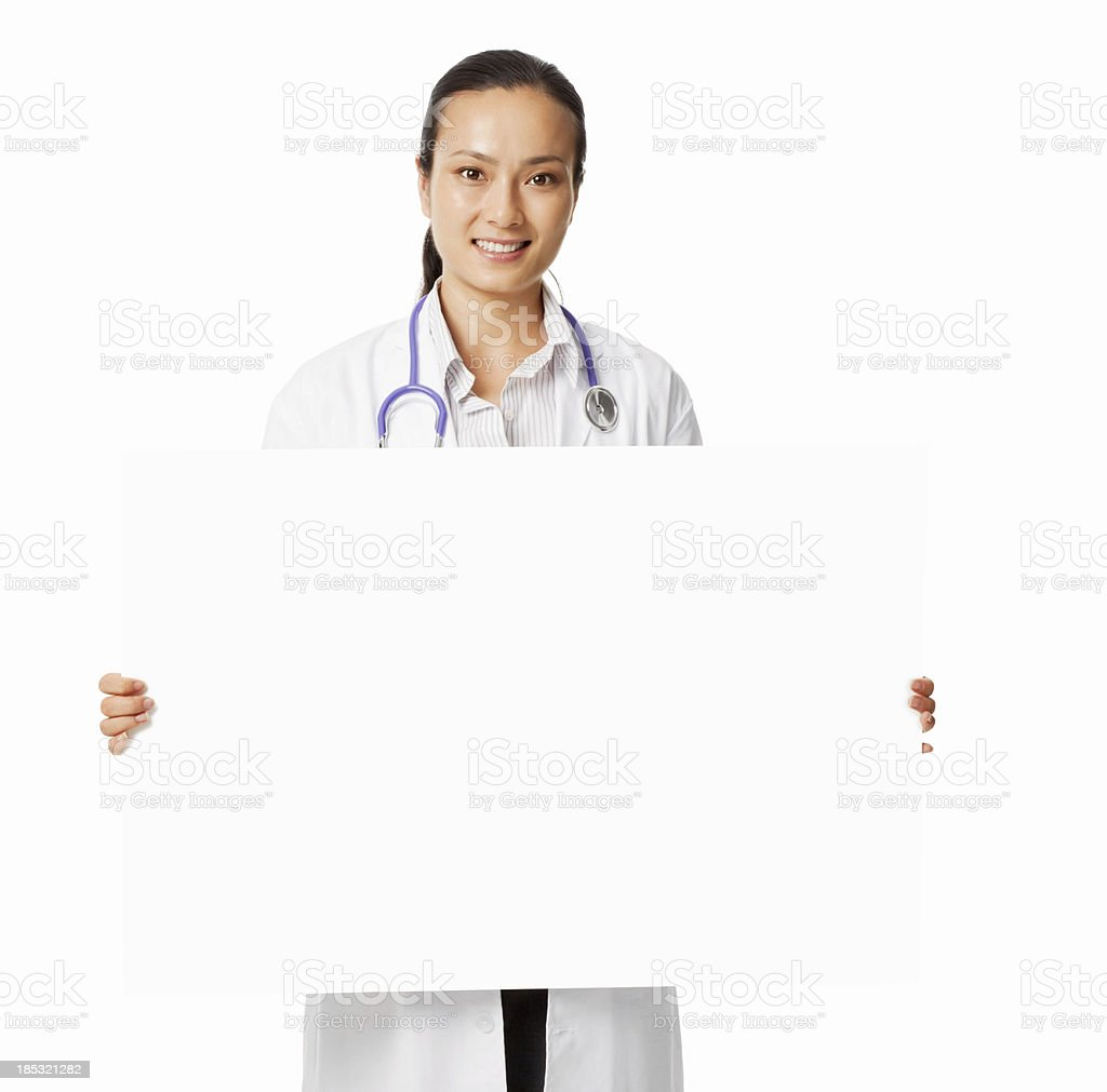 Attractive Asian Female Doctor Holding a Blank Sign - Isolated royalty-free stock photo