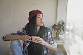 Attractive Asian female hipster drinking coffee cafe