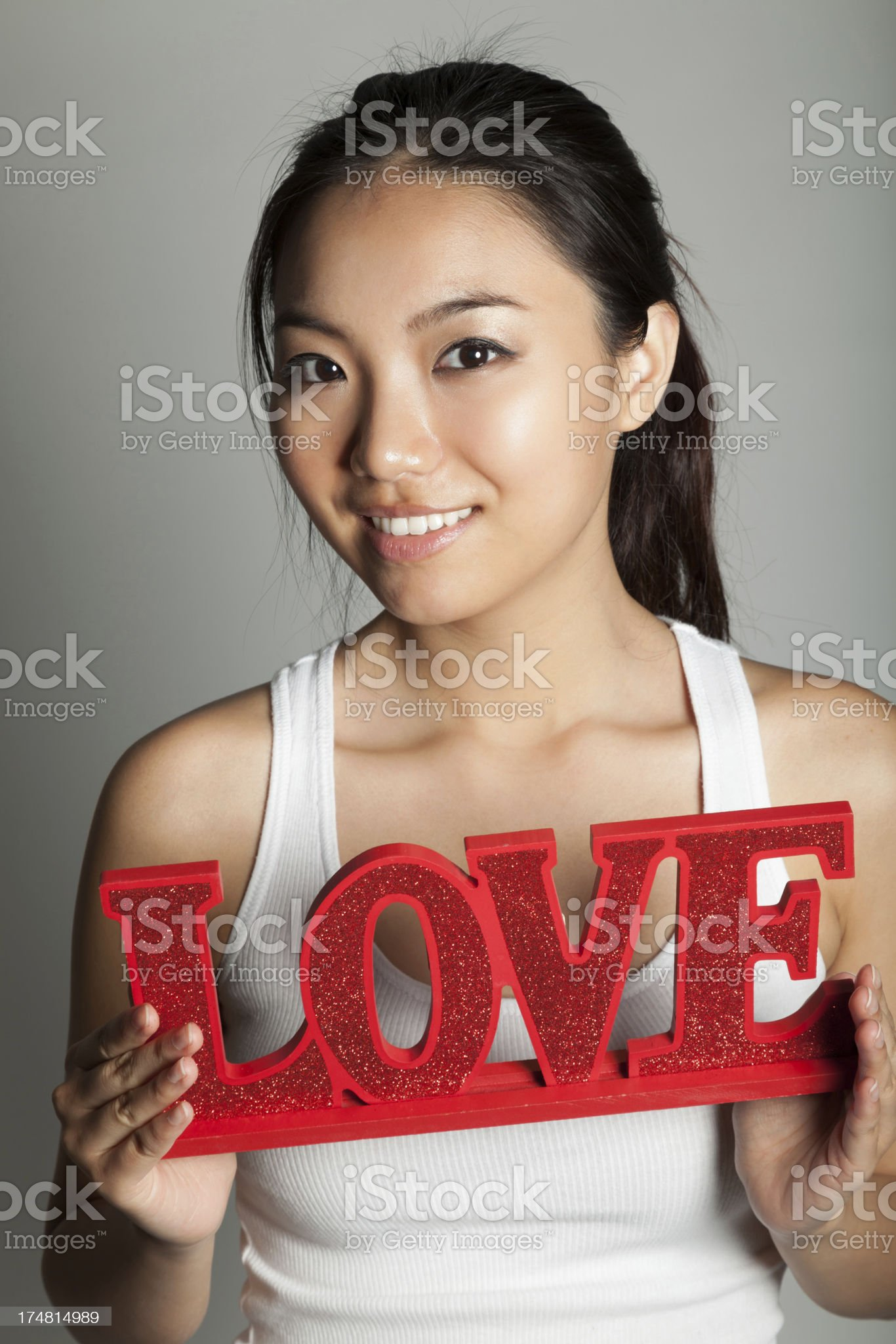 Attractive Asian girl on a grey background royalty-free stock photo