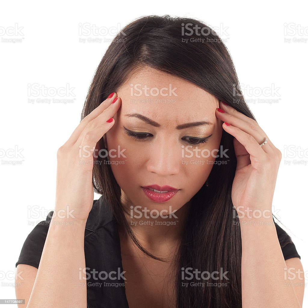 Attractive asian woman with head in hands royalty-free stock photo