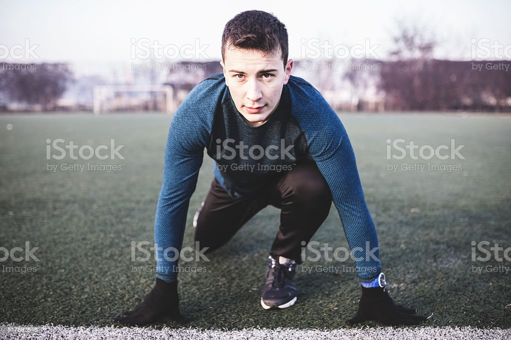 Attractive athlete is ready to run stock photo