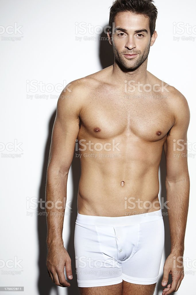 Attractive bare-chested male in underwear stock photo