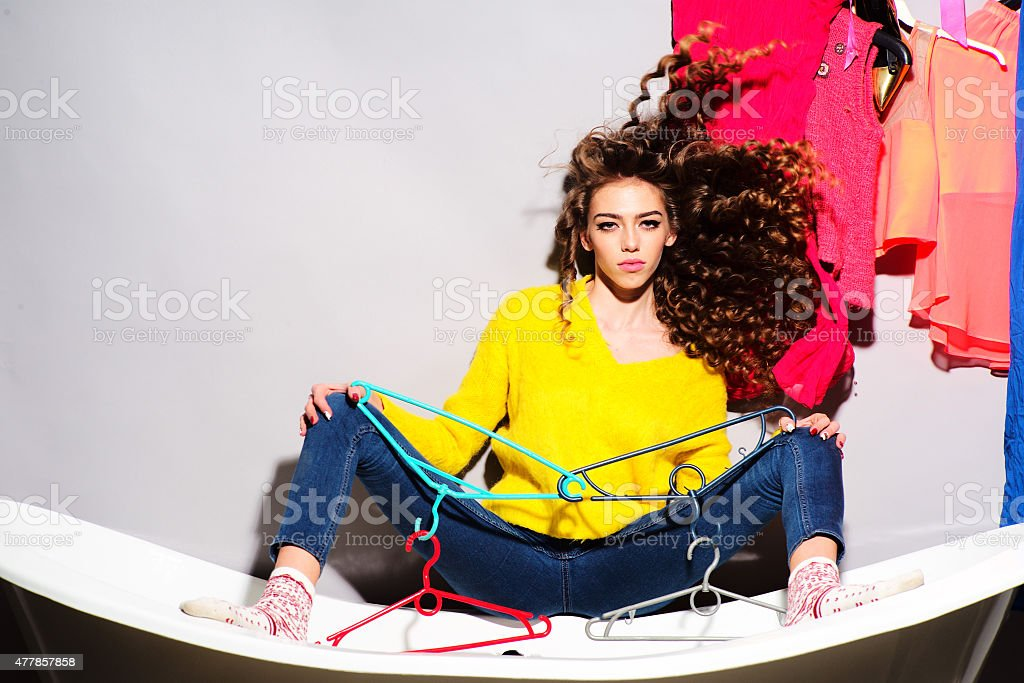 Attractive beautiful young woman on bathtub stock photo
