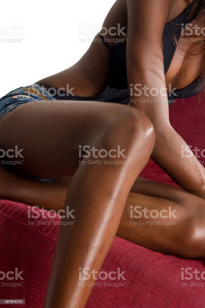 Attractive black party girl on a red sofa royalty-free stock photo