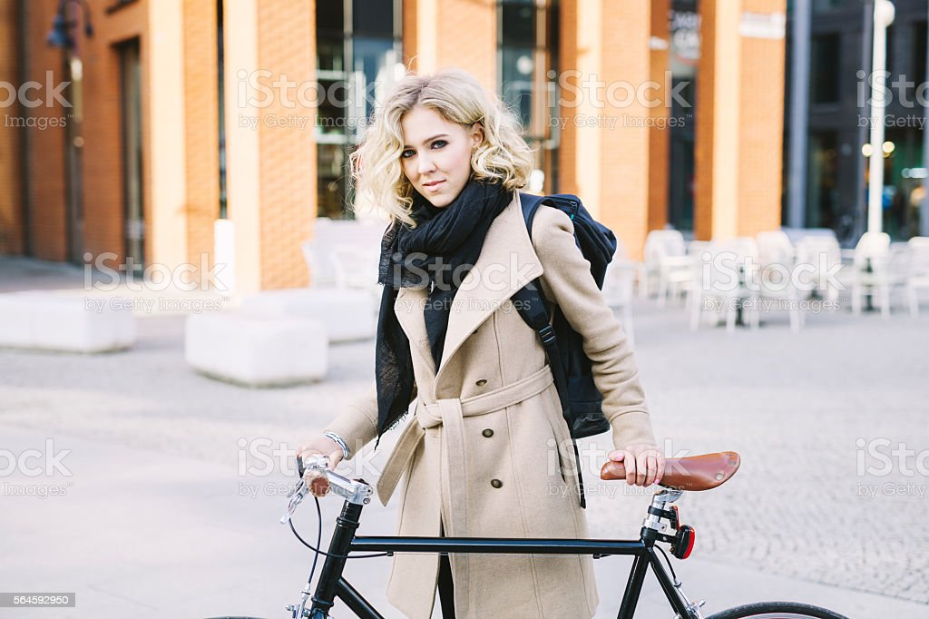 Attractive Blond Female CEO Cycling To Work stock photo