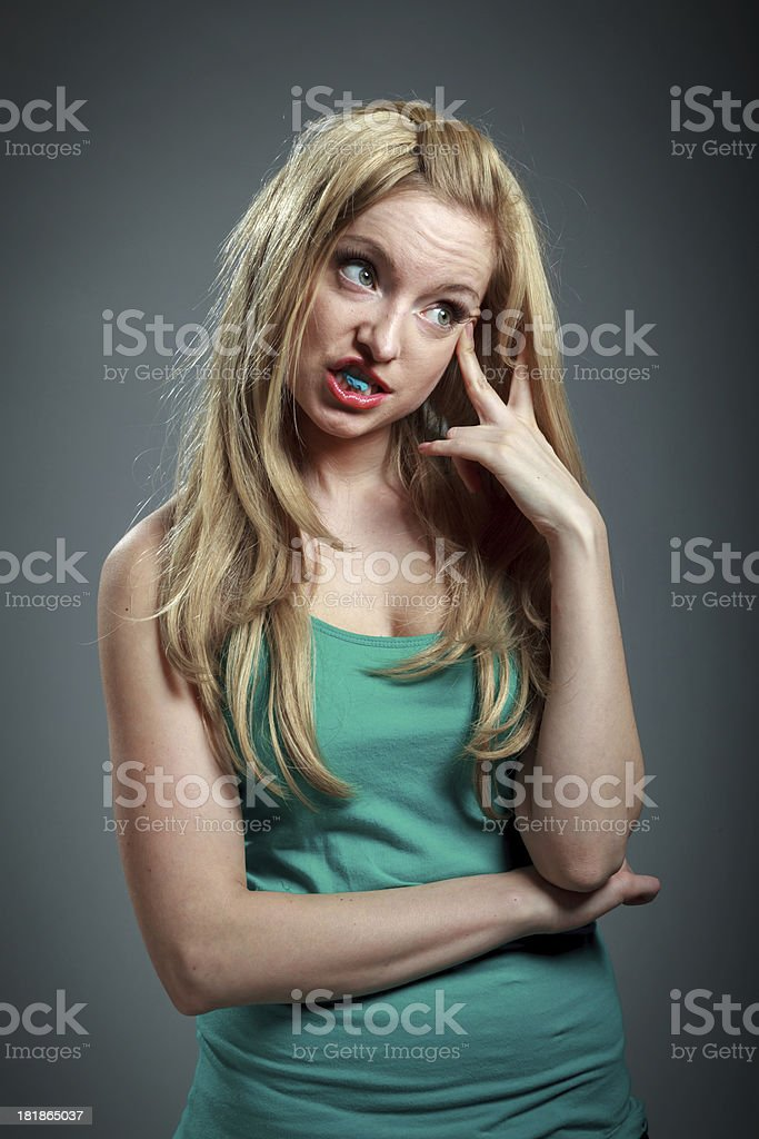 Attractive blond girl in green t-shirt royalty-free stock photo