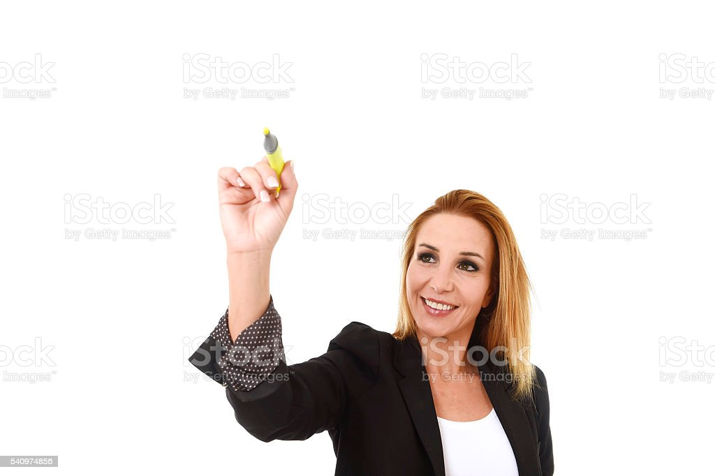 attractive blond successful businesswoman holding marker writing on transparent board stock photo