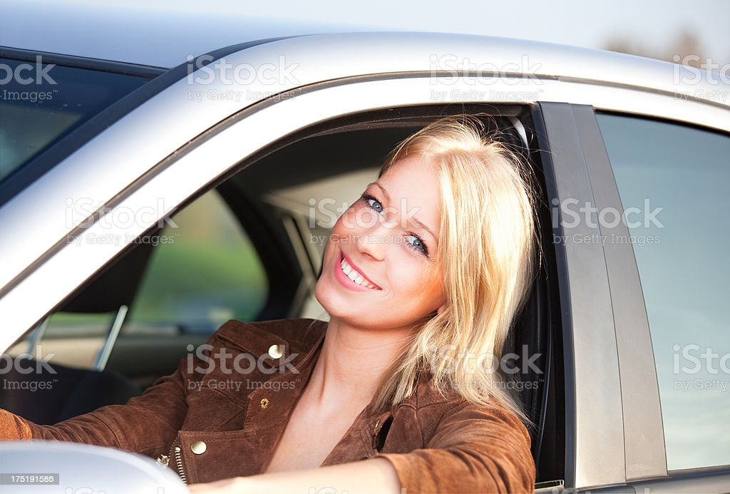 attractive blond teenager in her car royalty-free stock photo
