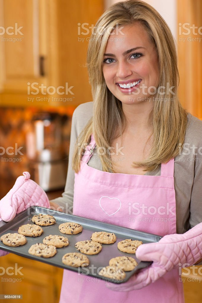 Attractive Blond Woman Baking Chocolate Chip Cookies royalty-free stock photo