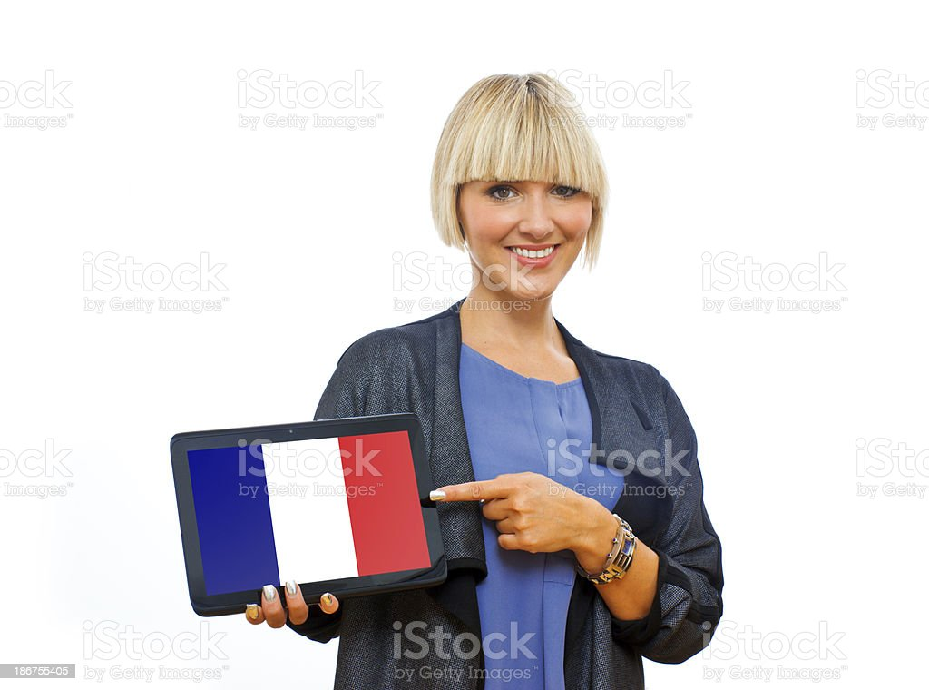 attractive blond woman holding tablet with france flag royalty-free stock photo