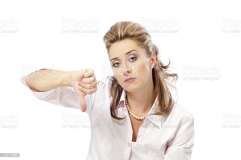Attractive blond woman with thumb down stock photo