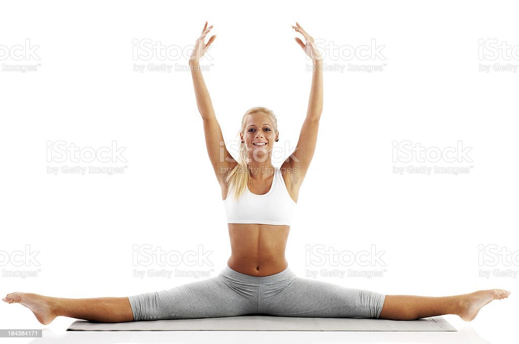 Attractive blonde girl doing gymnastics. stock photo
