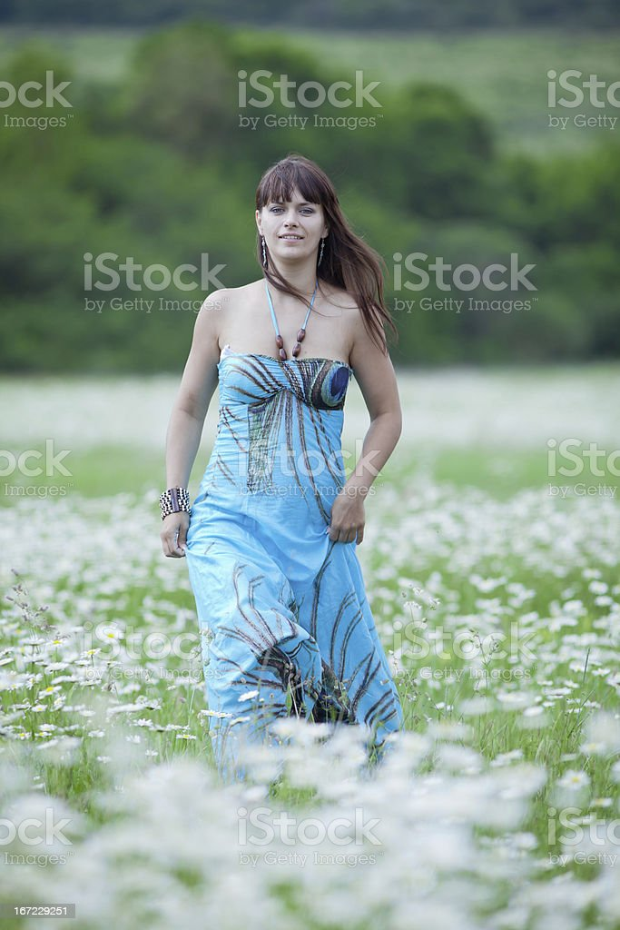 Attractive blonde in chamomile field royalty-free stock photo