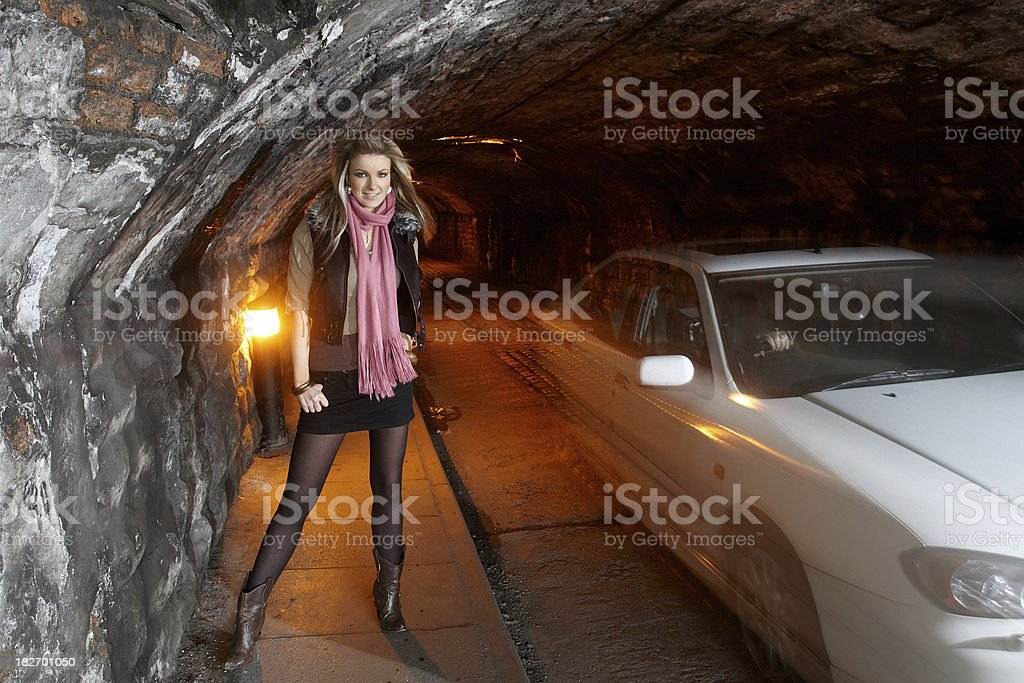 Attractive blonde  model subway tunnel background stock photo