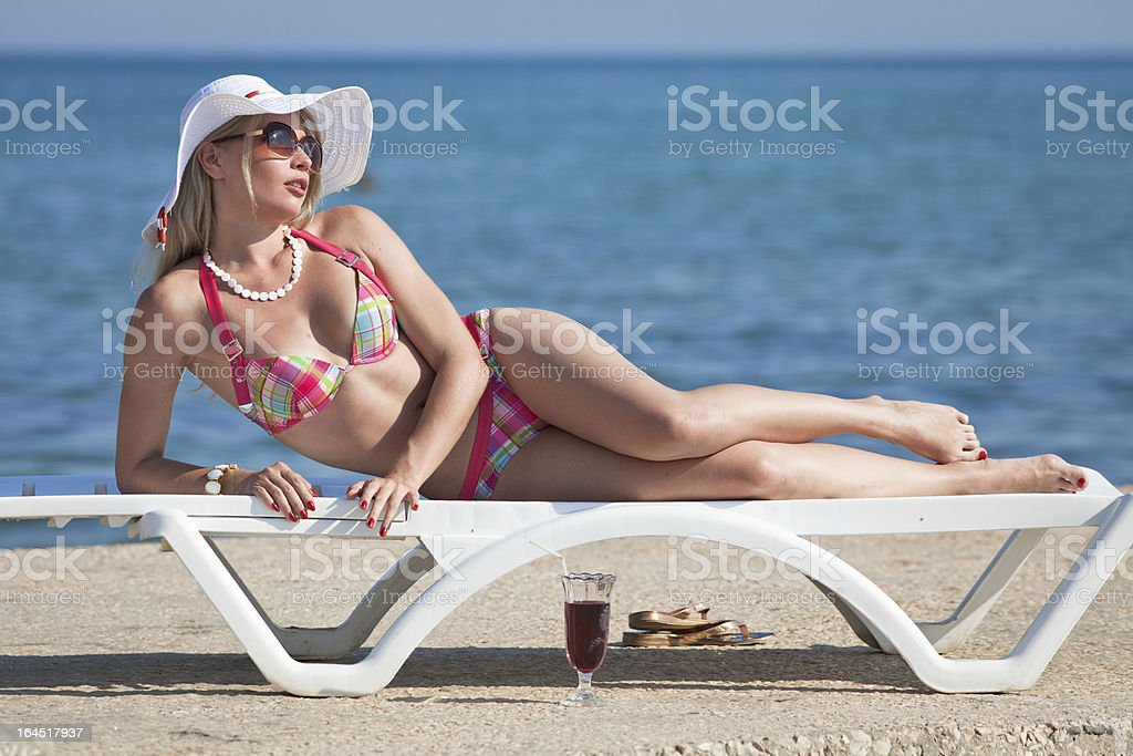 Attractive blonde on the beach royalty-free stock photo