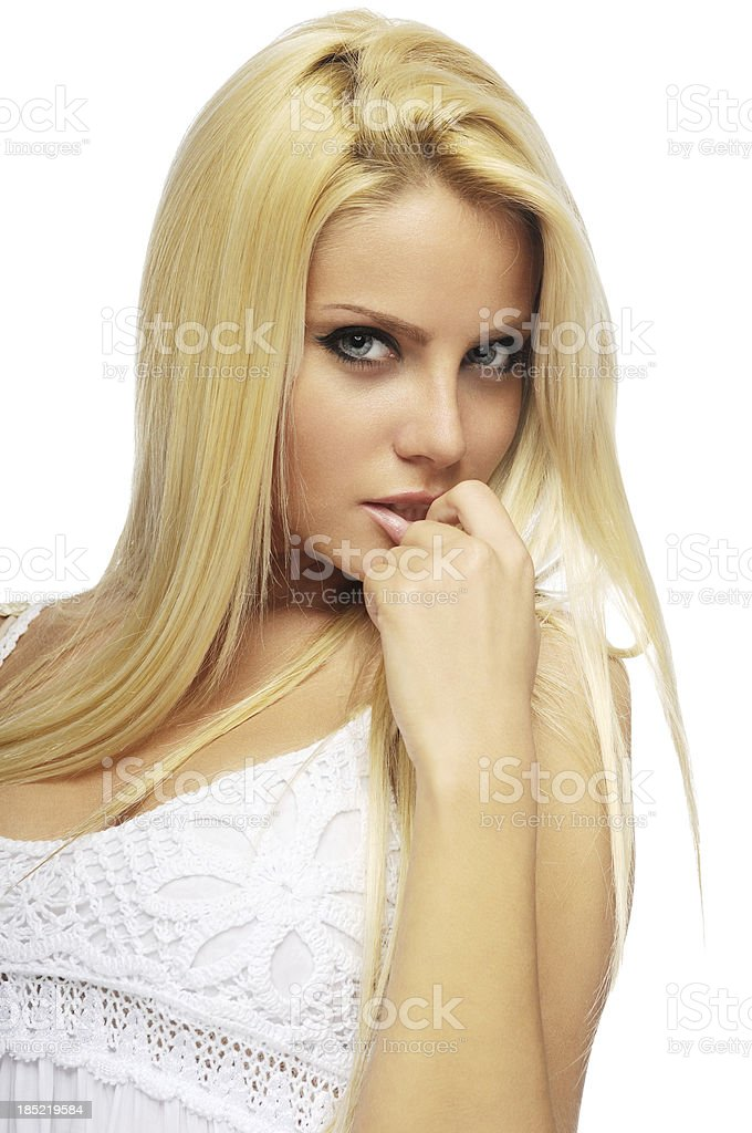 attractive blonde with finger in mouth royalty-free stock photo