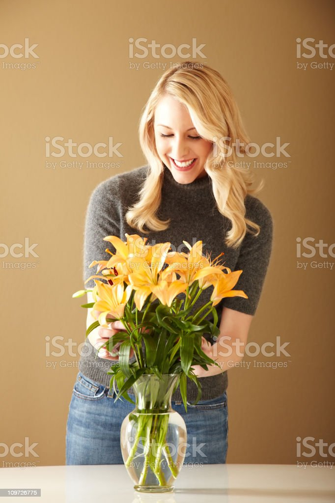 Attractive Blonde Woman Arranging Flowers royalty-free stock photo