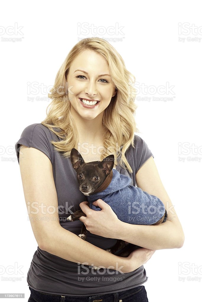 Attractive Blonde Woman Holding a Pet Dog royalty-free stock photo