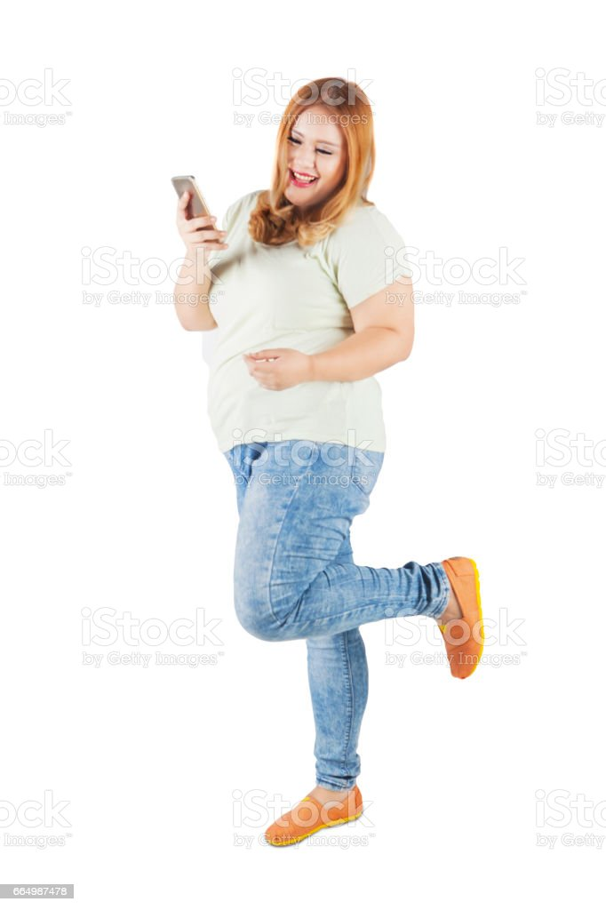 Attractive blonde woman holds smartphone stock photo