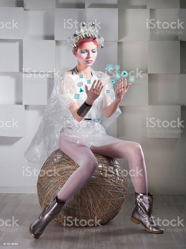 Attractive blonde woman touching the button in virtual interface stock photo